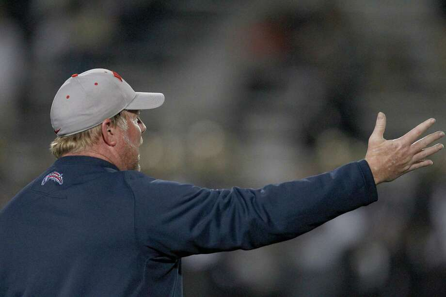 11/15/13: Dawson Eagles head coach Eric Wells yells at the officials after the Foster Falcons scored a safety on Dawson in a high school 4A  playoff football game at CCISD Veteran's Memorial Stadium in League City, TX. Photo: Thomas B. Shea, For The Chronicle / © 2013 Thomas B. Shea