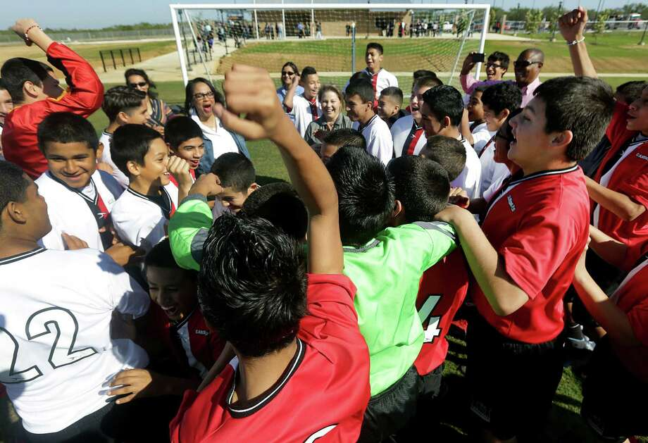 Members of the two soccers teams at Matthey Middle School show their excitement after the ribbon-cutting at Mission City Youth Soccer Complex across from the school. Photo: Photos By Bob Owen / San Antonio Express-News