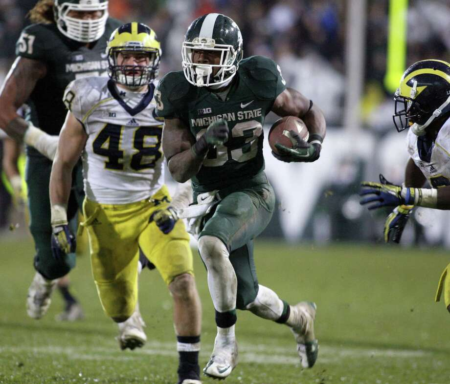 Michigan State RB Jeremy Langford has four straight 100-yard games, including 120 against archrival Michigan on Nov. 2. Photo: Al Goldis / Associated Press