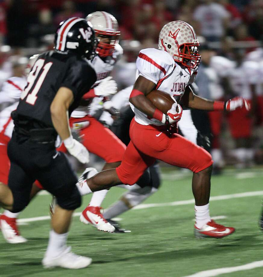 Judson High School running back Jo'von Kyle outruns Churchill defenders Nov. 15, 2013 to make the second touchdown of the game for Judson at Comalander Stadium. Photo: Cynthia Esparza, For The San Antonio Express-News / For the San Antonio Express-News