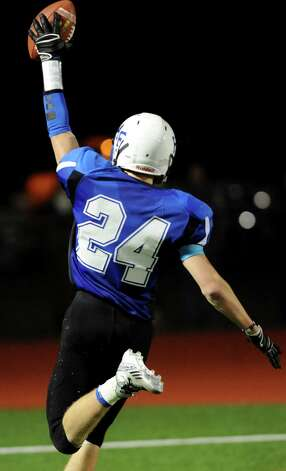 Hoosick Falls' David Hardesty runs into the endzone after picking up a fumble during their Class C regional football semifinal against Ogdensburg on Friday, Nov. 15, 2013, at Stillwater High in Stillwater, N.Y. (Cindy Schultz / Times Union) Photo: Cindy Schultz / 00024622A