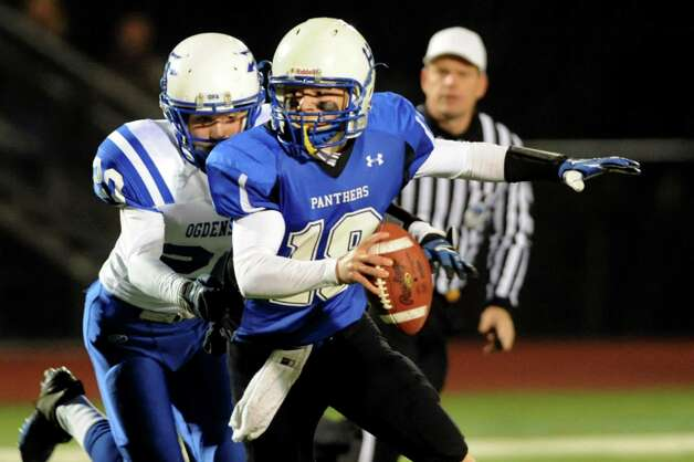 Hoosick Falls' quarterback Garrett Wright, right, gets pressure from Ogdensburg's Taylor Richardson during their Class C regional football semifinal on Friday, Nov. 15, 2013, at Stillwater High in Stillwater, N.Y. (Cindy Schultz / Times Union) Photo: Cindy Schultz / 00024622A