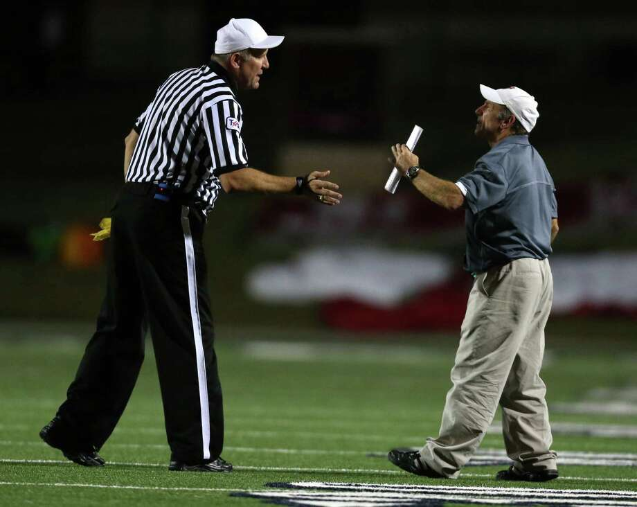 Memorial head coach Gary Koch, right, has words with an official during the second half of a high school football bi-district playoff game against Westside, Friday, November 15, 2013, at Tully Stadium in Houston. Photo: Eric Christian Smith, For The Chronicle