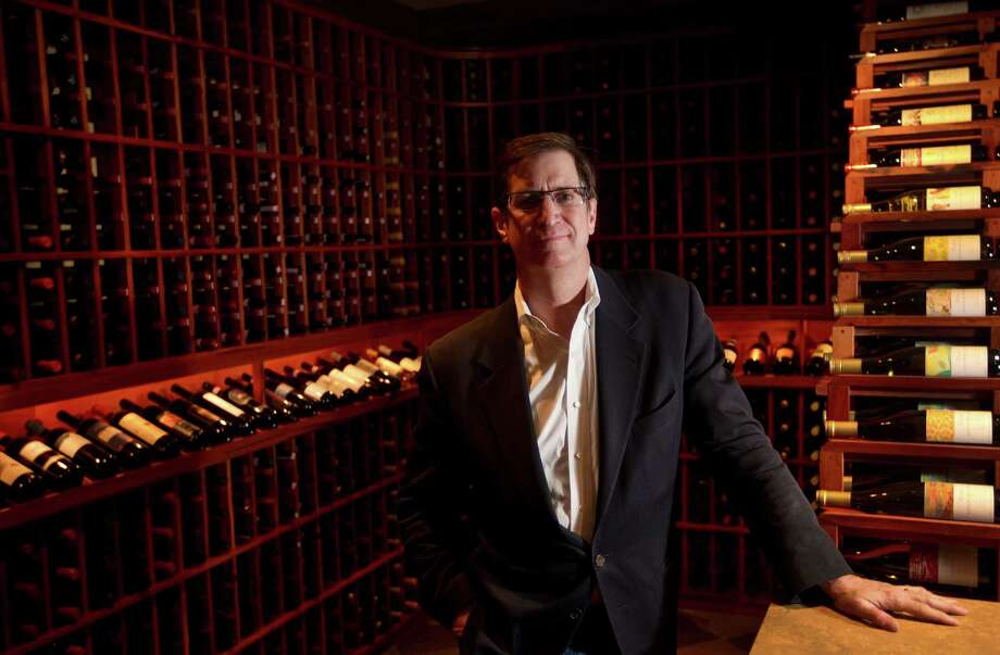 Jost Lunstroth fell in love with wine while managing Tony's restaurant in the '80s. His Nos Caves Vin provides wine storage, and he also builds wine rooms. Photo: Marie D. De Jeséºs, Staff / © 2013 Houston Chronicle