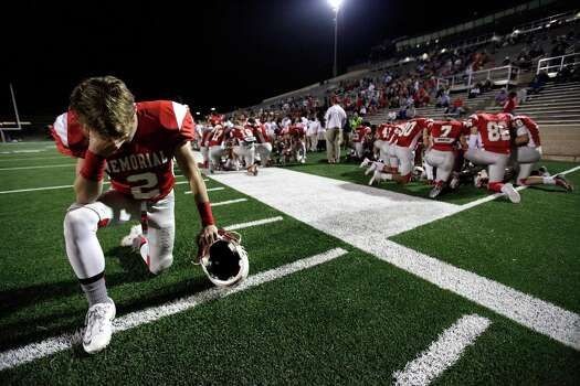 Memorial's Davis McDaniel (2) prays before a high school football bi-district playoff game against Westside, Friday, November 15, 2013, at Tully Stadium in Houston. Photo: Eric Christian Smith, For The Chronicle