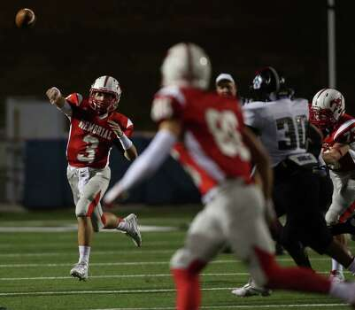 Memorial's Mathhew Jordan (3) throws a pass during the first half of a high school football bi-district playoff game against Westside, Friday, November 15, 2013, at Tully Stadium in Houston. Photo: Eric Christian Smith, For The Chronicle