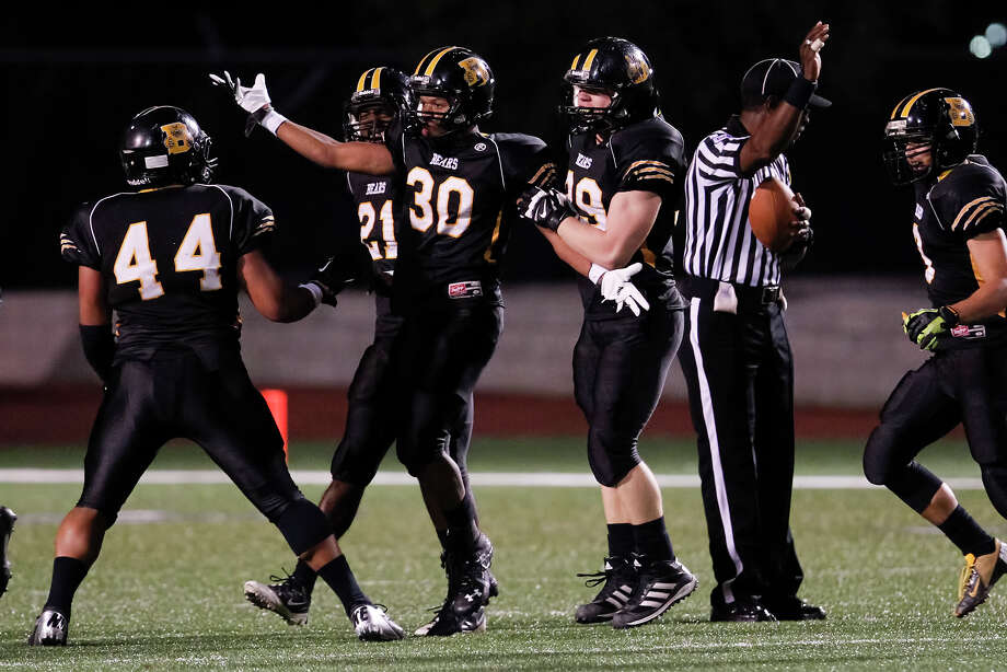 Brennan's Christian Dillard (30) is congratulated by teammates after his second quarter interception during their Class 4A Division I first round playoff game with Clemens at Farris Stadium on Friday, Nov. 15, 2013. Brennan shut out the Buffaloes 56-0.  MARVIN PFEIFFER/ mpfeiffer@express-news.net Photo: MARVIN PFEIFFER, Marvin Pfeiffer/ Express-News / Express-News 2013