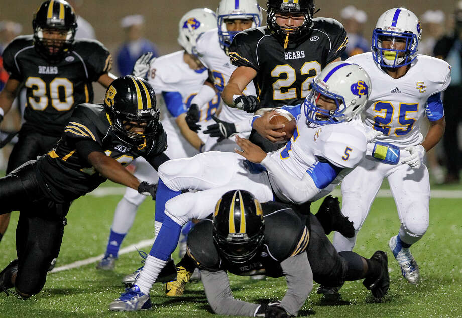 Brennan's D.J. Allen (below) undercuts Clemens Kamren Baker (center) on a kickoff return during the first half of their Class 4A Division I first round playoff game at Farris Stadium on Friday, Nov. 15, 2013.  Brennan shut out the Buffaloes 56-0.  MARVIN PFEIFFER/ mpfeiffer@express-news.net Photo: MARVIN PFEIFFER, Marvin Pfeiffer/ Express-News / Express-News 2013