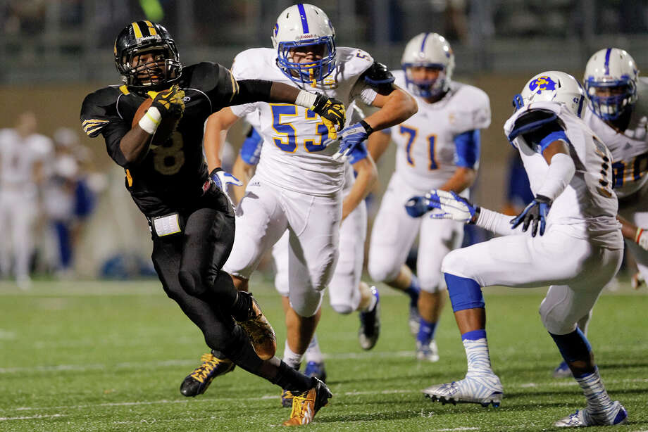 Brennan's Nathaniel Wells Jr (left) breaks away from the Clemens defense on a 36-yard touchdown run during the second half of their Class 4A Division I first round playoff game at Farris Stadium on Friday, Nov. 15, 2013. Brennan shut out the Buffaloes 56-0. MARVIN PFEIFFER/ mpfeiffer@express-news.net Photo: MARVIN PFEIFFER, Marvin Pfeiffer/ Express-News / Express-News 2013