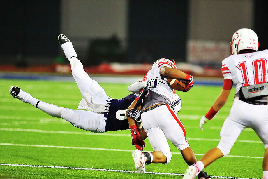 Port Neches-Groves Indians linebacker Bradley Broussard dives and tackles a Crosby Cougars running back at Barbers Hill, Friday. Michael Rivera/@michaelrivera88