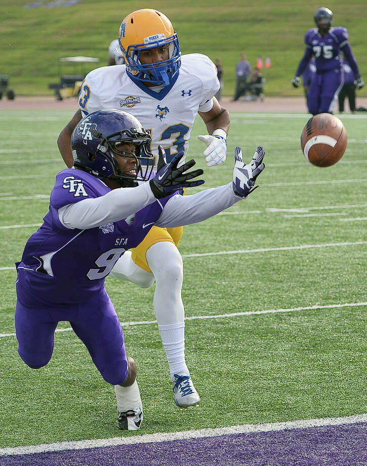 Stephen F. Austin State wide receiver DJ Ward, front, dives for a Brady Attaway pass while being defended by McNeese State cornerback Gabe Hamner during a game in Nacogdoches, Texas, earlier this season. SFA plays at Lamar on Saturday. Kickoff is scheduled for 6 p.m. Photo: Andrew D. Brosig, MBR / The Daily Sentinel