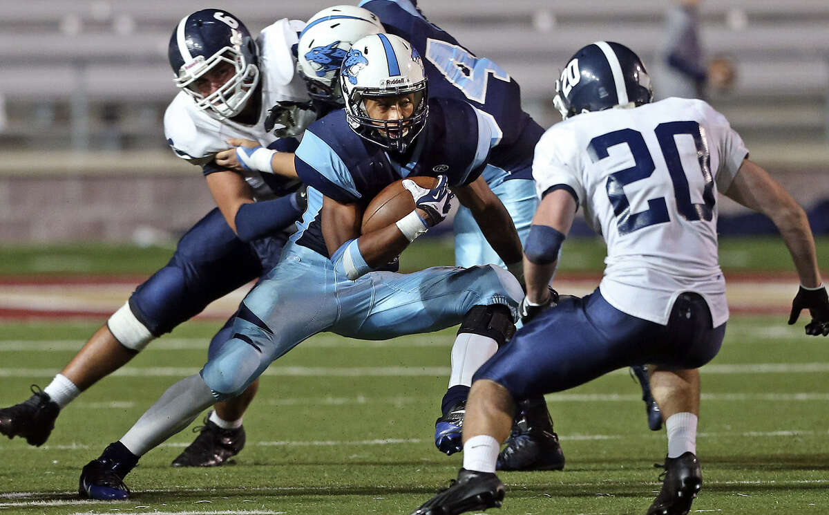 Johnson's Darion McElhannon slices his way through the Smithson Valley defense during a first-round matchup at Bobcat Stadium. McElhannon had a rushing TD in the Jaguars' win.