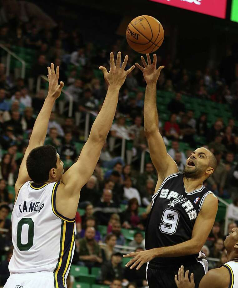 Tony Parker shoots over Utah's Enes Kanter during the first half. The Spurs' guard scored a game-high 22 points, with 14 coming in the fourth quarter. Photo: George Frey / Associated Press