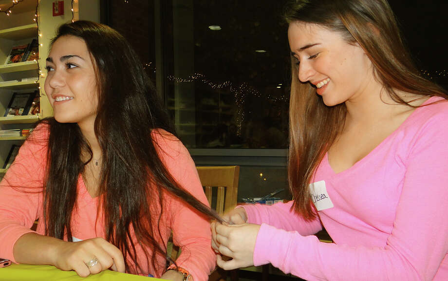 "Lilly Valente, 15, and fellow Westporter Chelsea Mullen, 15, at the ""Hunger Games"" event Friday at the Westport Library. Photo: Mike Lauterborn / Westport News contributed"