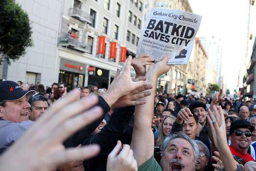 "Jerry Quiles, who works for the San Francisco Chronicle in their Marin Circulation center, passes out copies of the ""Gotham City Chronicle"" with the headline ""Batkid Saves City"" in Union Square during a Make-a-Wish benefit where Miles Scott, 5 saves Gotham as Batkid in San Francisco, Calif., Friday November 16, 2013. Photo: Jason Henry, Special To The Chronicle"