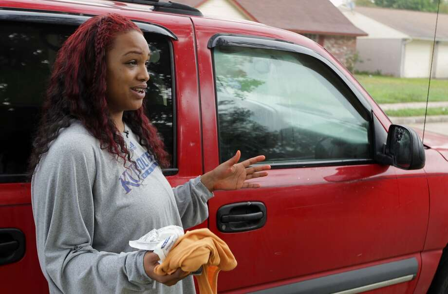 Juliette Goudeau describes the a shooting outside a party in the 4400 block of Tiffany, the vehicle in which Goudeau was a passenger sustained multiple gunshots Saturday, Nov. 16, 2013, in Houston.  ( James Nielsen / Houston Chronicle ) Photo: James Nielsen, Houston Chronicle