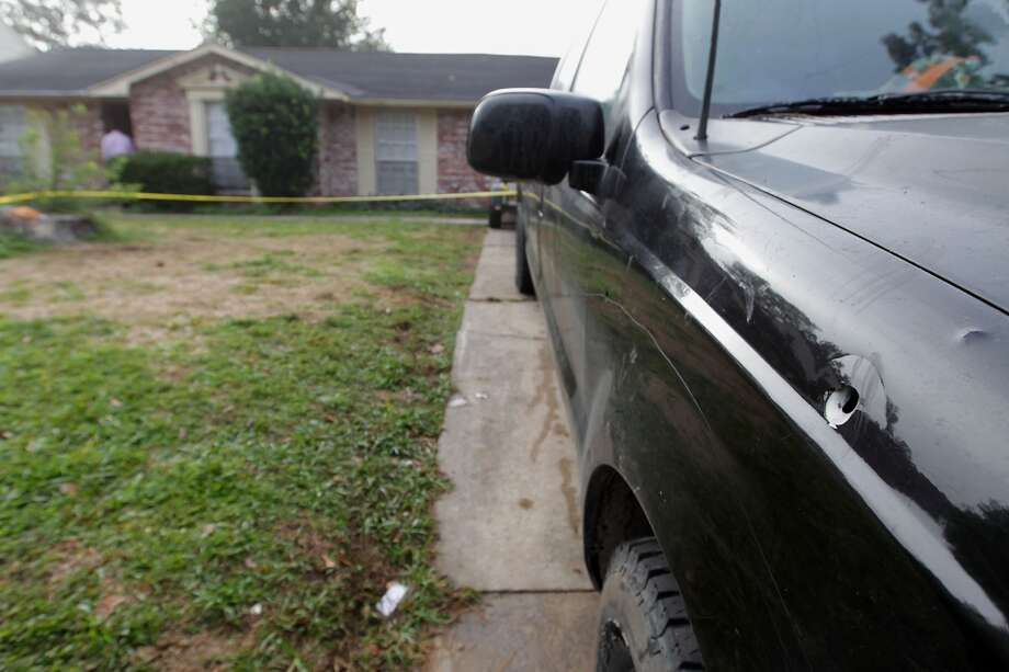A bullet hole in a pickup truck at the scene of a shooting outside a party in the 4400 block of Tiffany Saturday, Nov. 16, 2013, in Houston.  ( James Nielsen / Houston Chronicle ) Photo: James Nielsen, Houston Chronicle