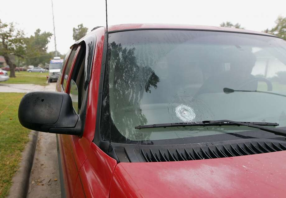 A multiple bullet holes in a vehicle at the scene of a shooting outside a party in the 4400 block of Tiffany Saturday, Nov. 16, 2013, in Houston.  ( James Nielsen / Houston Chronicle ) Photo: James Nielsen, Houston Chronicle