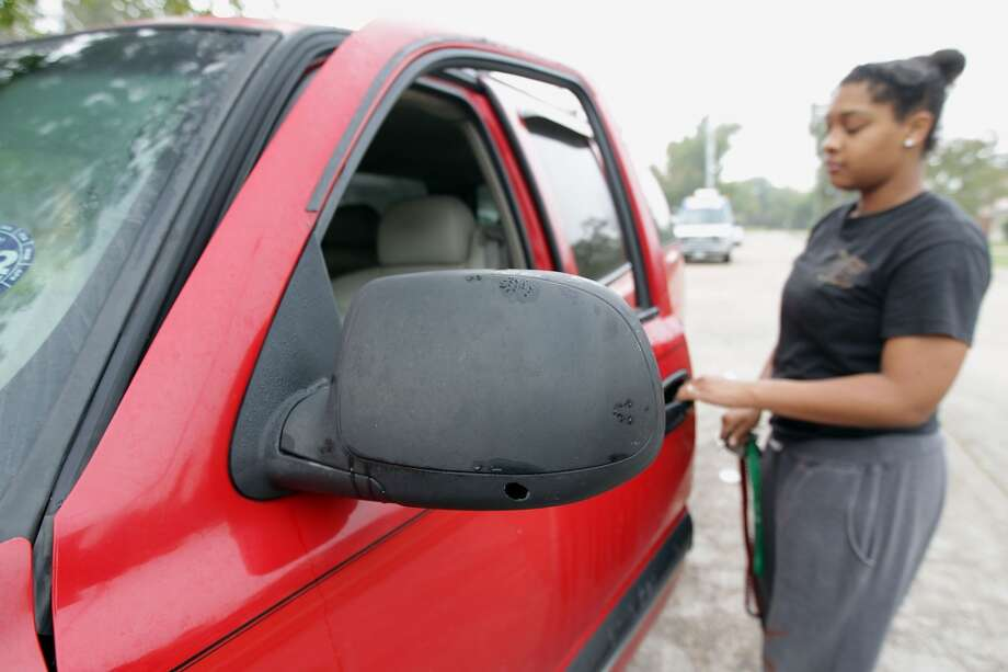 Jasome Goudeau opens the door of a vehicle which she was driving when shooting broke out in the street outside a party in the 4400 block of Tiffany , Goudeau's vehicle sustained multiple gunshots Saturday, Nov. 16, 2013, in Houston.  ( James Nielsen / Houston Chronicle ) Photo: James Nielsen, Houston Chronicle