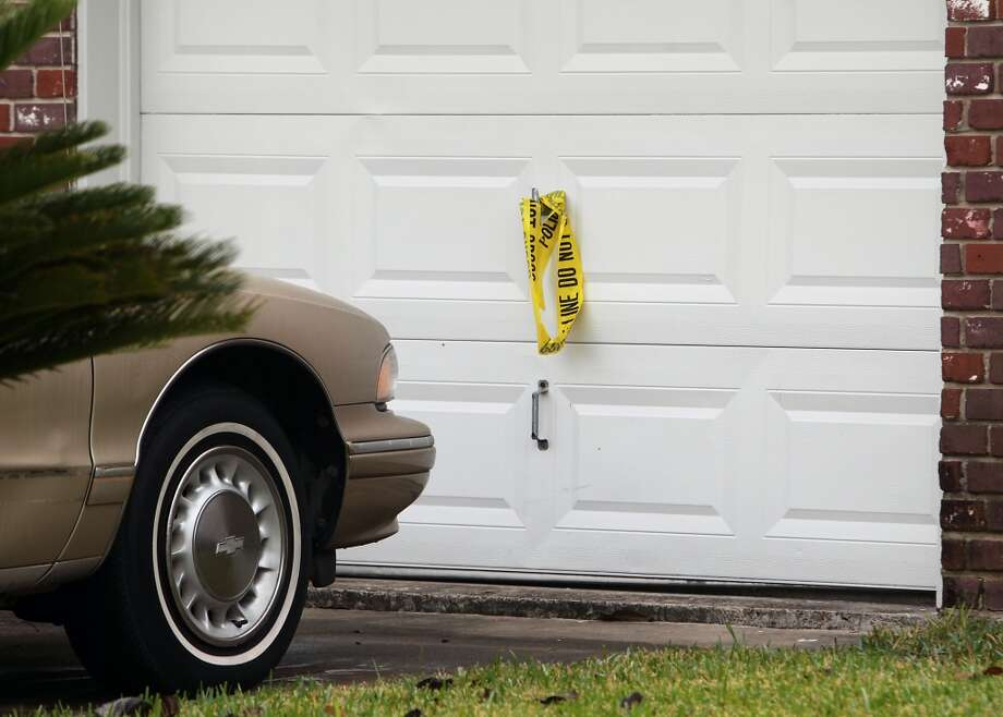 Police crime scene tape on a garage door at the scene of a shooting outside a party in the 4400 block of Tiffany Saturday, Nov. 16, 2013, in Houston.  ( James Nielsen / Houston Chronicle ) Photo: James Nielsen, Houston Chronicle