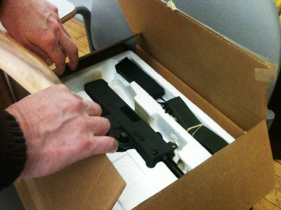A Mac-11 machine gun was one of the many guns turned into police. The man who turned it in said he bought it for protection decades ago. Photo: Wes Duplantier, Connecticut Post