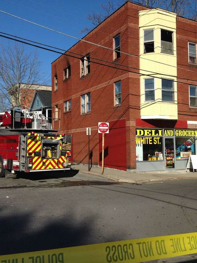 Fire crews were called to 45 White St. in Cohoes to battle a fire on Saturday, Nov. 16, 2013. (Matthew Hamilton/Times Union)