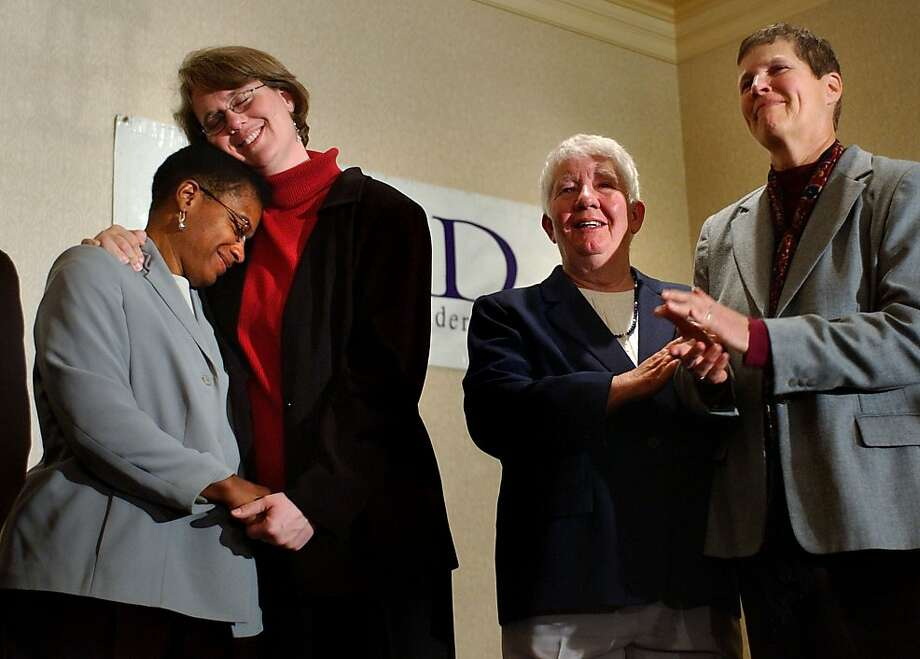 Gina Smith (left), Heidi Norton, Gloria Bailey and Linda Davies celebrate the Massachusetts Judicial Court's ruling on same-sex marriage on Nov. 18, 2003. Photo: Charles Krupa, Associated Press