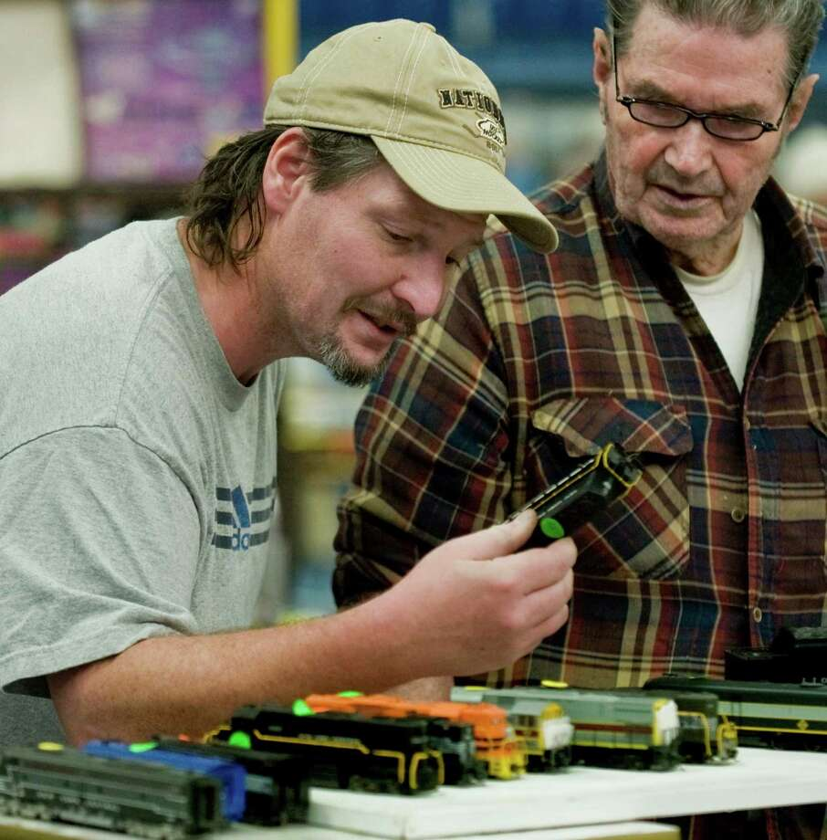 Matt Donovan and his father Daniel, a retired Metro North employee, look over some HO scale trains at Greenberg's Train & Toy Show held at the O'Neill Center. Saturday, Nov. 16, 2013 Photo: Scott Mullin / The News-Times Freelance