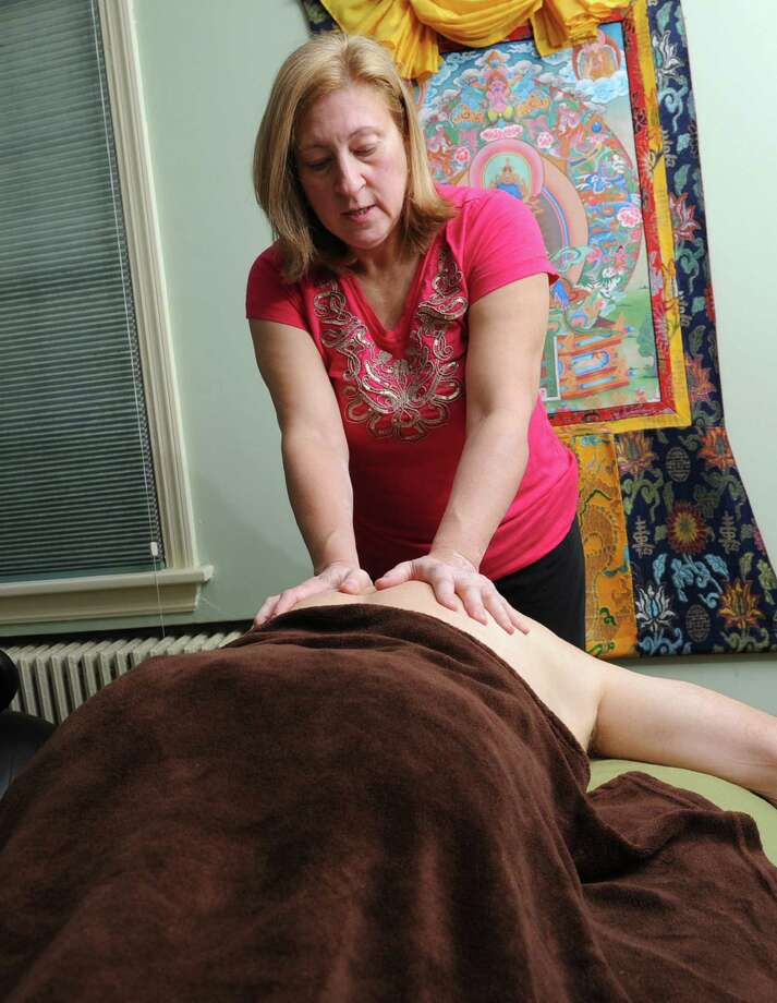 Massage Therapist Marjorie Knechtel works on a client in her home office on Thursday, Nov. 14, 2013 in Albany N.Y. (Lori Van Buren / Times Union) Photo: Lori Van Buren / 00024649A