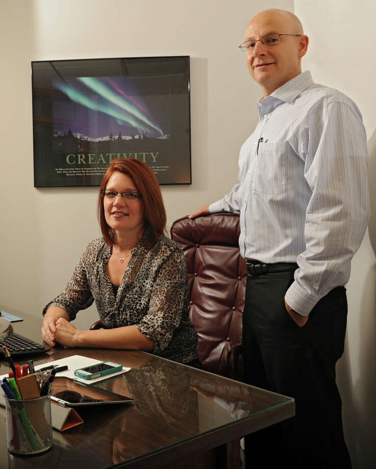Owners Heather Hamlin and her husband Jim Martin in the office of their business J&H Troy Ltd.  Monday, Nov. 11, 2013 in Troy, N.Y. (Lori Van Buren / Times Union) Photo: Lori Van Buren / 00024589A