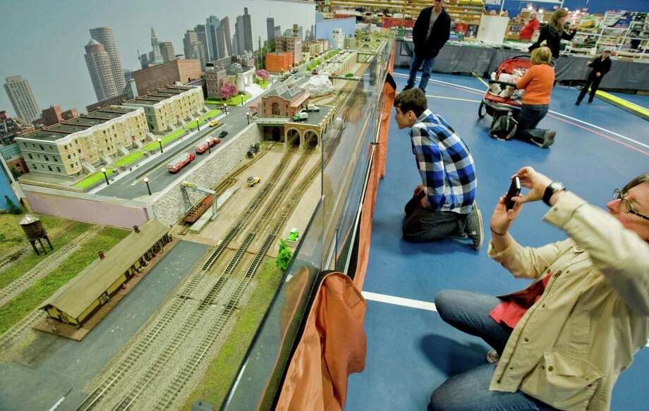Many are fascinated with this large display with much detail and moving trains at Greenberg's Train & Toy Show held at the O'Neill Center. Saturday, Nov. 16, 2013 Photo: Scott Mullin / The News-Times Freelance