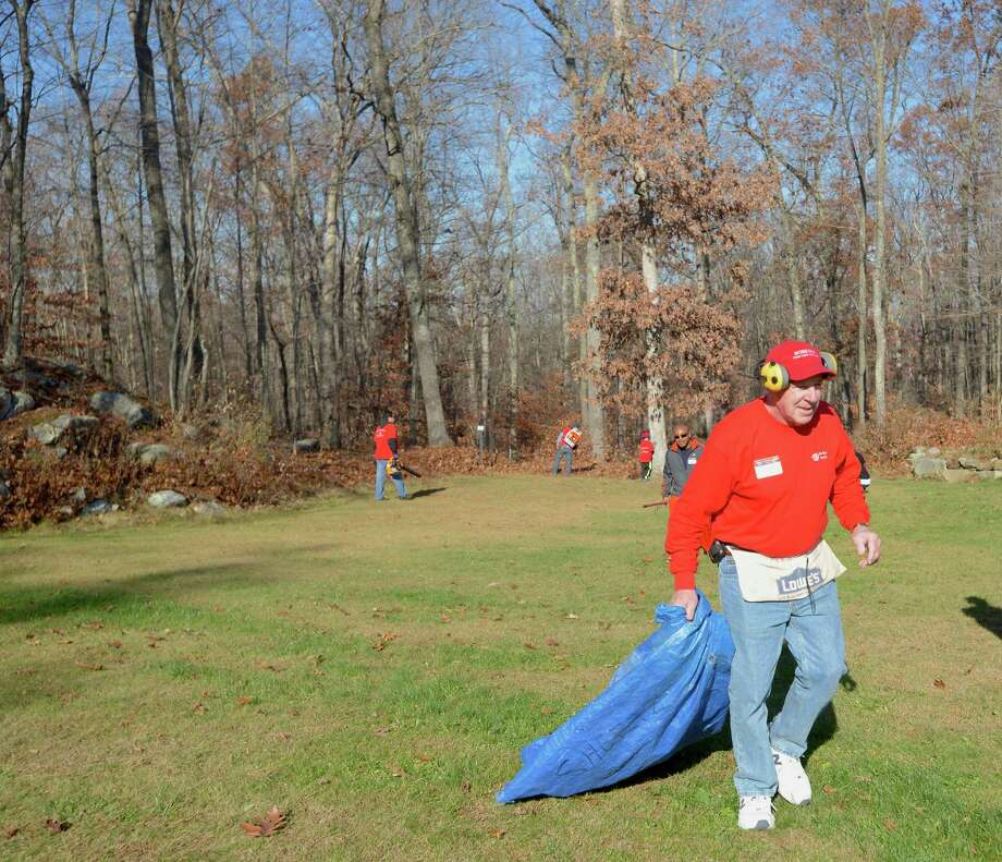Photos from the annual Rake n Bake in Brookfield, Conn. on Saturday November 16, 2013. Volunteers rake a seniors yard in return for a baked good that is brought to a group lunch for the volunteers. Photo: H John Voorhees III / The News-Times Freelance