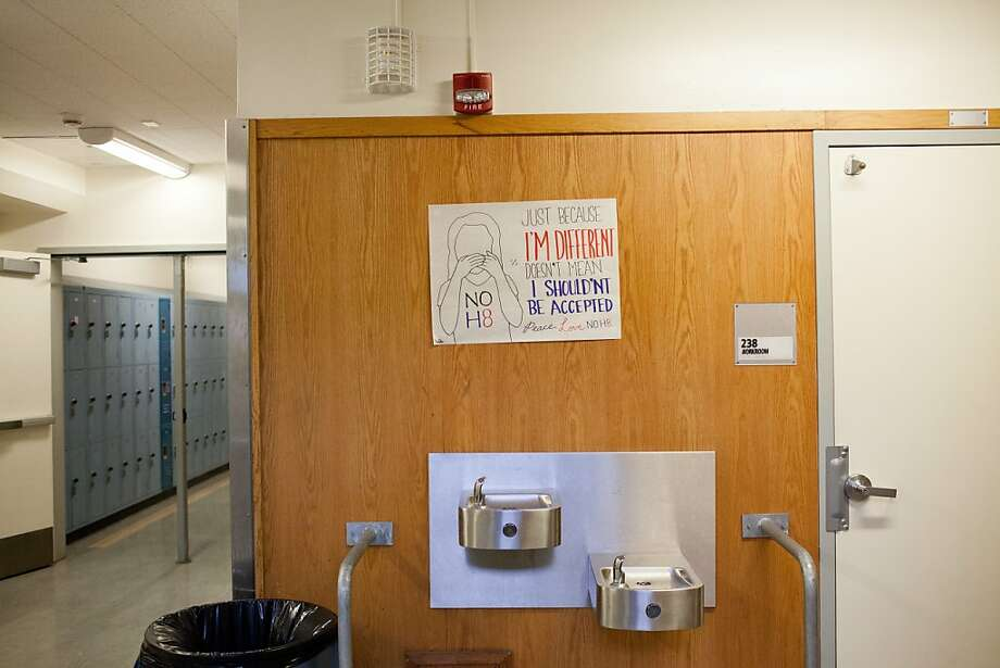 """A sign hanging above a water fountain in Oakland High School, where Richard Thomas attended school, reads """"Just because I'm different doesn't mean I shouldn't be accepted, Please Love No H8 (No Hate)"""" in Oakland, Calif., Thursday, November 14, 2013. Photo: Jason Henry, Special To The Chronicle"""