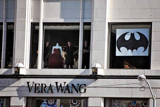 Onlookers in a Vera Wang store show their support and take in the sight of thousands of people gathered in Union Square to cheer on Batkid. The Make-A-Wish foundation, SF officials and thousands of volunteers came together to transform San Francisco into Gotham City to grant 5-year-old Leukemia survivor Miles Scott his wish of being Batkid on Friday, Nov. 15, 2013. Photo: Sara Gobets, Special To The Chronicle
