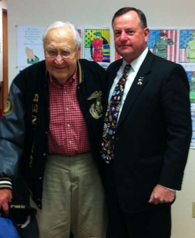 A Mother Teresa Academy veterans ceremony included a visit from retired Army Col. Ken Curley, a graduate of the U.S. Military Academy at West Point, pictured with Norbert Vincent Woods, retired Marine officer who fought at Iwo Jima during World War II. His wife Mary Woods, a retired Naval Supply Officer during World War II, also was honored.  (Submitted by John G. Metallo)
