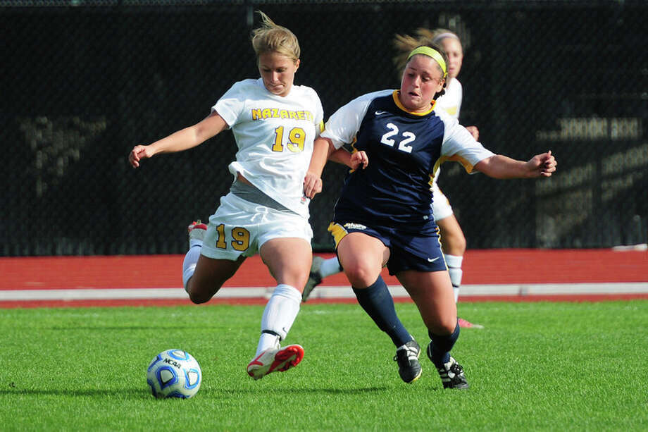 Nazareth's Annie Czelusniak and Ithaca's Amanda Callanan, former high school teammates for Ballston Spa, face off in a college soccer contest.