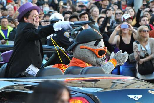 The Penguin taunts Batkid as he kidnaps Giants' mascot Lou Seal outside of Union Sqaure. The Make-A-Wish foundation, SF officials and thousands of volunteers came together to transform San Francisco into Gotham City to grant 5-year-old Leukemia survivor Miles Scott his wish of being Batkid on Friday, Nov. 15, 2013. Photo: Sara Gobets, Special To The Chronicle