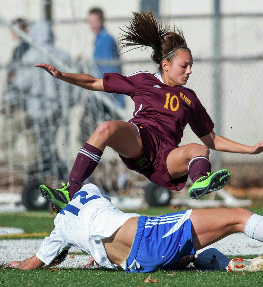 St Joseph high school's Jenna Bike collides with Suffield high school's Jillian Consolini in front of the Suffield goal during the CIAC class LL girls soccer championship game played at Falcon Field, Meriden, CT on Saturday, November 16th, 2013. Photo: Mark Conrad / Connecticut Post Freelance