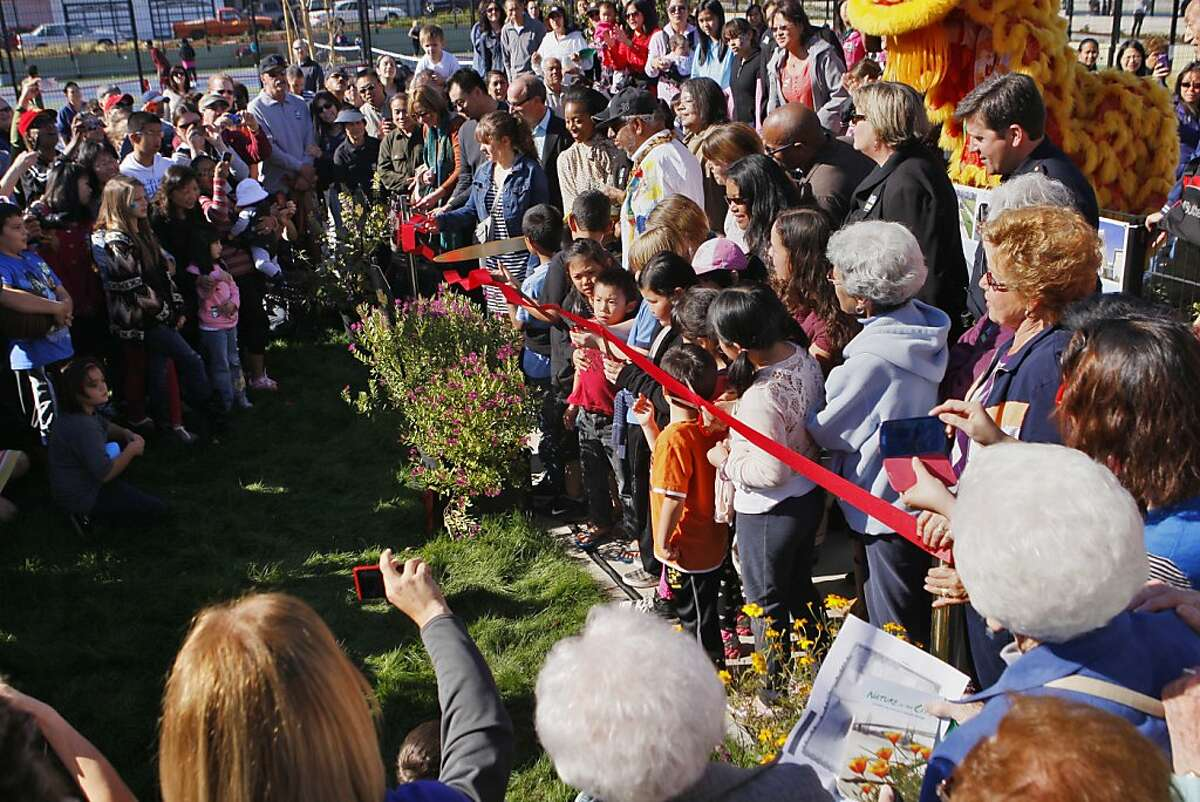 School children cut a red ribbon to celebrate the reopening of Palega park in San Francisco, Calif. on Saturday, Nov. 16, 2013.