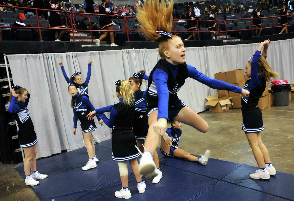 The Saratoga Blue Streak team warms up before competing in the Eastern Region Pop Warner Cheer and Dance Championships at the Times Union Center on Saturday Nov. 16, 2013 in Albany, N.Y. The competition continues at the Times Union Ceter on Sunday. (Michael P. Farrell/Times Union)