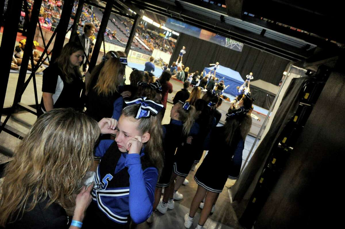 Saratoga Blue Streak team head coach Shannon Austin, left, talks with cheerleader Brianna Aldrich before warm ups during the Eastern Region Pop Warner Cheer and Dance Championships at the Times Union Center on Saturday Nov. 16, 2013 in Albany, N.Y. (Michael P. Farrell/Times Union)