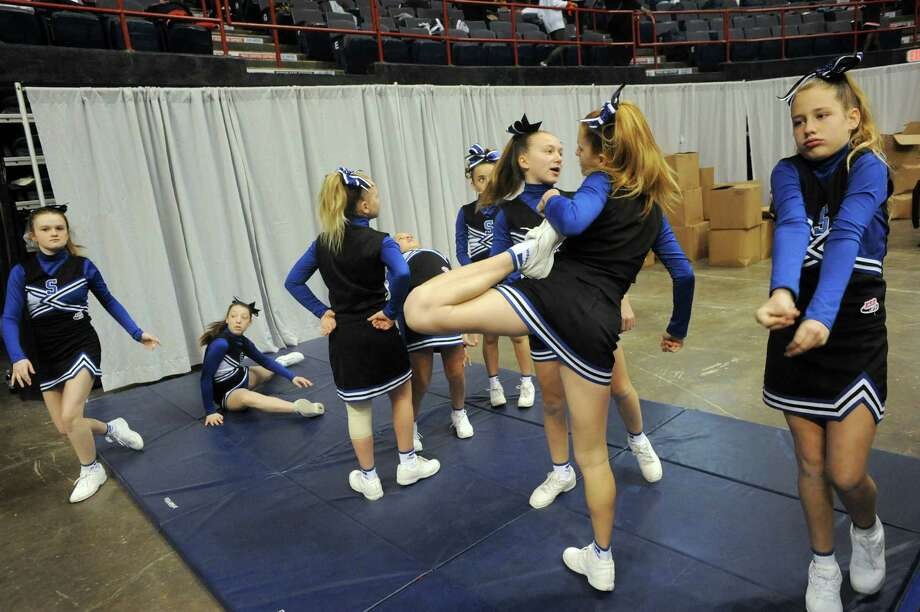 The Saratoga Blue Streak team warms up before competing in the Eastern Region Pop Warner Cheer and Dance Championships at the Times Union Center on Saturday Nov. 16, 2013 in Albany, N.Y. The competition continues at the Times Union Center on Sunday.  (Michael P. Farrell/Times Union) Photo: Michael P. Farrell / 00024616A