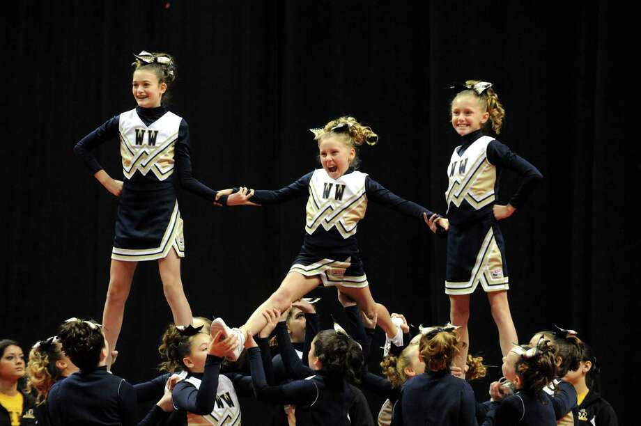 The Webster  Wildcats compete in the Eastern Region Pop Warner Cheer and Dance Championships at the Times Union Center on Saturday Nov. 16, 2013 in Albany, N.Y. The competition continues at the Times Union Center on Sunday.  (Michael P. Farrell/Times Union) Photo: Michael P. Farrell / 00024616A