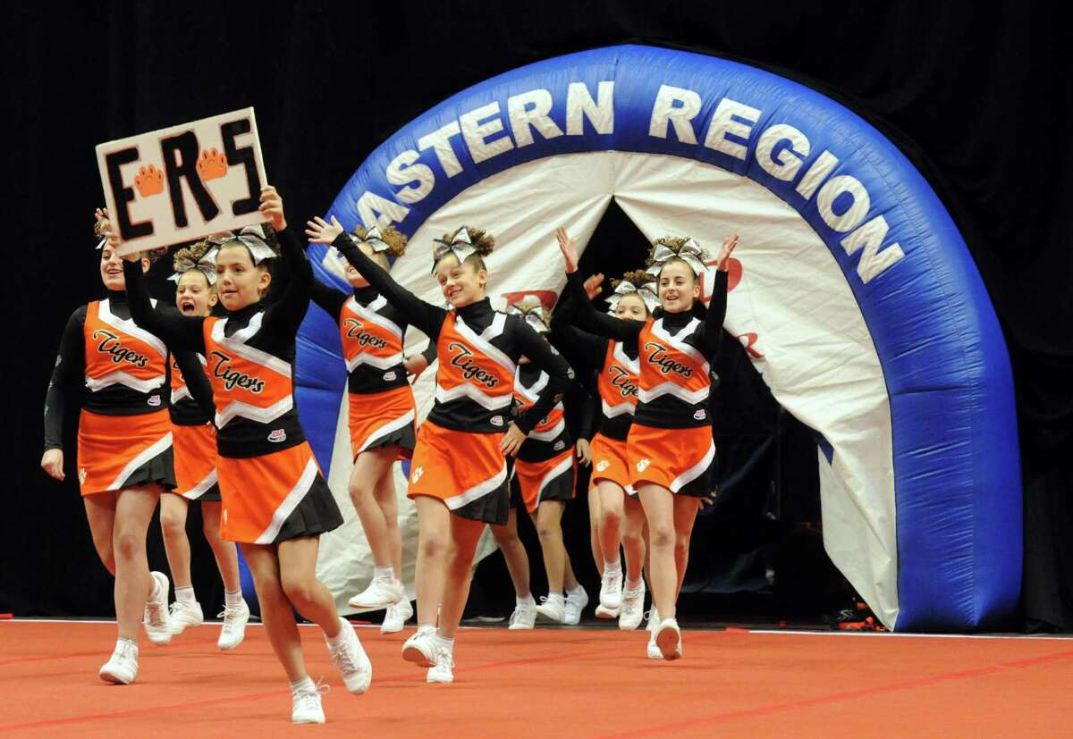 The Mexico Tigers compete in the Eastern Region Pop Warner Cheer and Dance Championships at the Times Union Center on Saturday Nov. 16, 2013 in Albany, N.Y. The competition continues at the Times Union Center on Sunday. (Michael P. Farrell/Times Union)