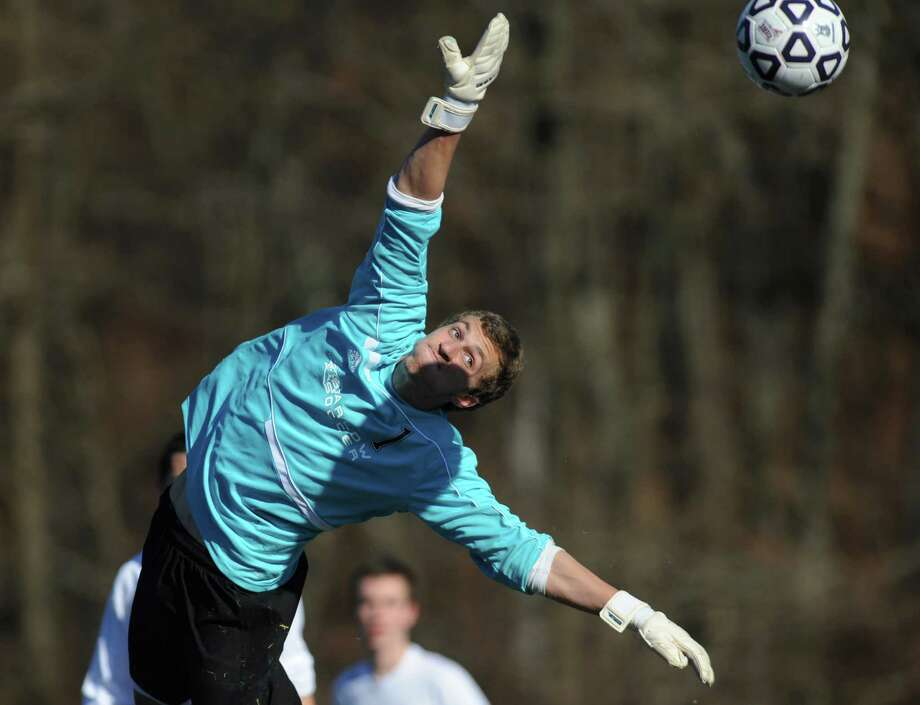 Joel Barlow goalie Peter Cohen allows a goal in Farmington's 4-0 win over Joel Barlow in the CIAC Class L high school boys soccer championship game at Municipal Stadium in Waterbury, Conn. on Saturday, Nov. 16, 2013. Photo: Tyler Sizemore / The News-Times