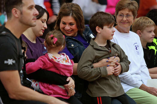 State Senator Leticia Van de Putte holds her grandson, Julian Stiles, 6, next to her daughter and Julian's mother, Nichole Van de Putte, left, holding her daughter, Marlo Stiles, 2, with husband, Jason Stiles, during the opening ceremony for the Walk/Run for Rex 5K at Morgan's Wonderland in San Antonio on Friday, Nov. 16, 2013. The event is held in name and inspiration for Van de Putte's grandson, Rex Van de Putte, who died at the age of five months of Sudden Infant Death Syndrome. The event was held to raise money for SIDS awareness. At right is Barbara San Miguel, the wife of Van de Putte's father, who passed away in June. Photo: Lisa Krantz, San Antonio Express-News / San Antonio Express-News