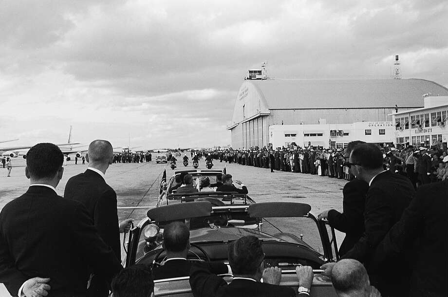 A rear view photo shows the length of the crowd lining the runway at San Antonio International Airport as the two couples, followed by a Secret Service car, head for ceremonies at Brooke Medical Center in San Antonio on Nov. 21, 1963. Photo: CECIL W. STOUGHTON, WHITE HOUSE