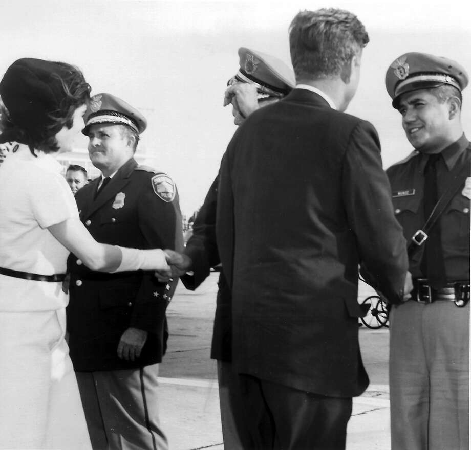 President and Mrs. John F. Kennedy in San Antonio during his visit on Nov. 21, 1963. On the right shaking JFK's hand is SAPD officer Johnny Munoz. Photo: EXPRESS-NEWS ARCHIVES