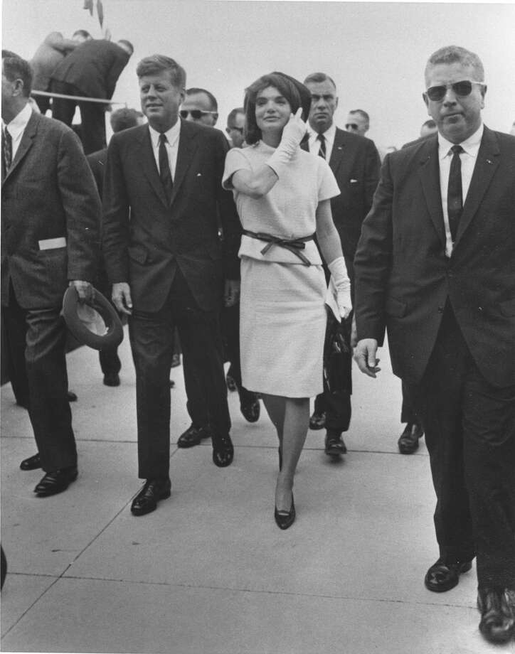 President John F. Kennedy and his wife, Jacqueline, are surrounded by security during their visit to San Antonio on Nov. 21, 1963, one day before his assassination. Photo: EXPRESS-NEWS FILE PHOTO