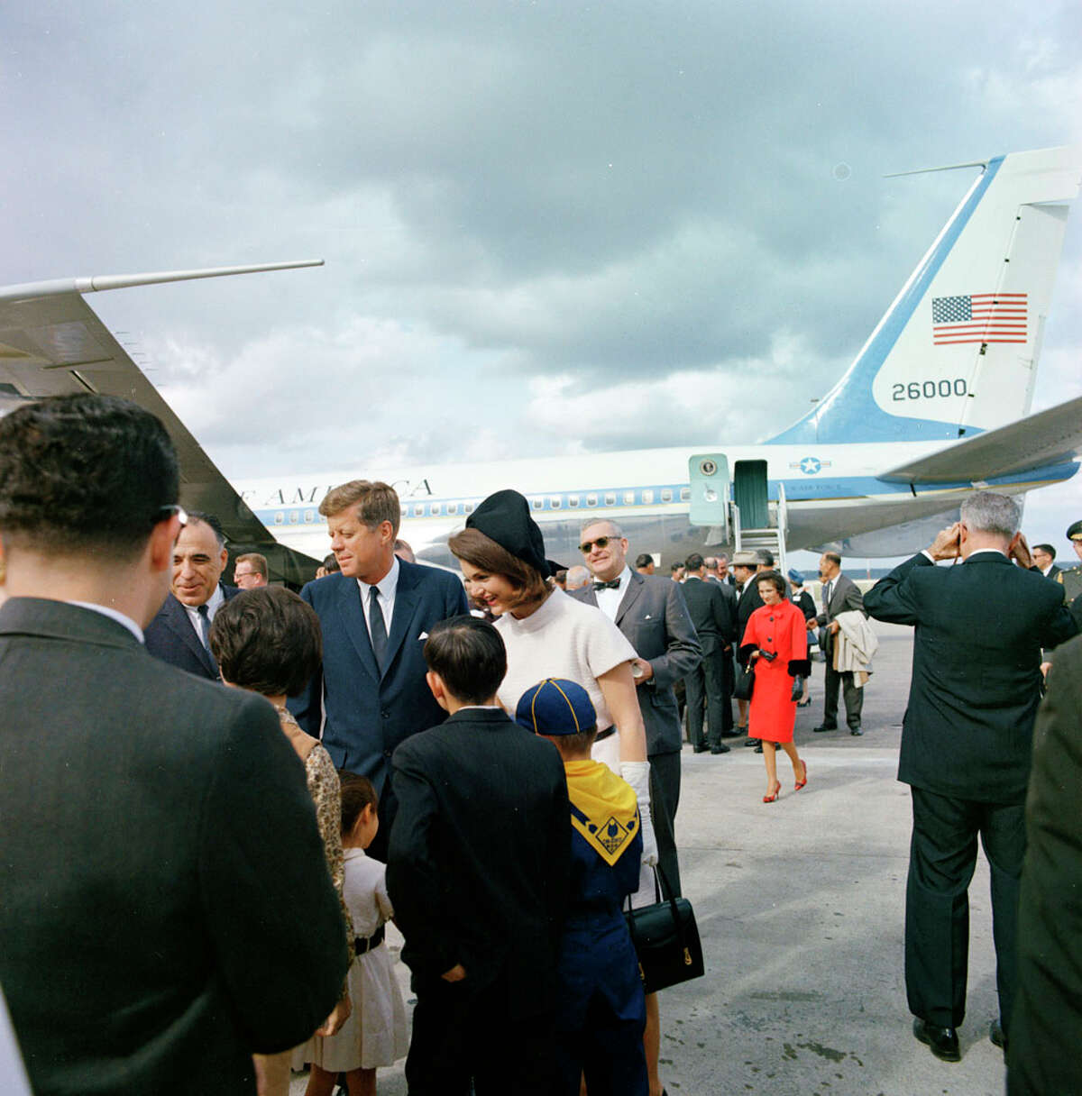 U.S. Congressman Henry B. Gonzalez, four of his children and wife Bertha (walking up behind them) were on hand when the Kennedys arrived Nov. 21, 1963 at San Antonio International Airport. All Photos Courtesy of Creative Differences production company. ST-C420-30-63 21 November 1963 Trip to Texas: San Antonio: Arrival at San Antonio International Airport Please credit